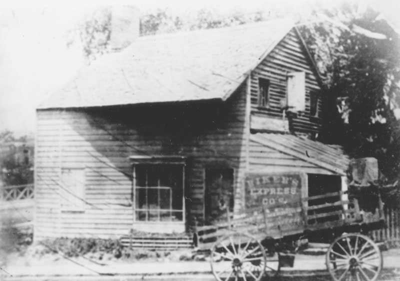 Store in Reeders with a delivery wagon out front.