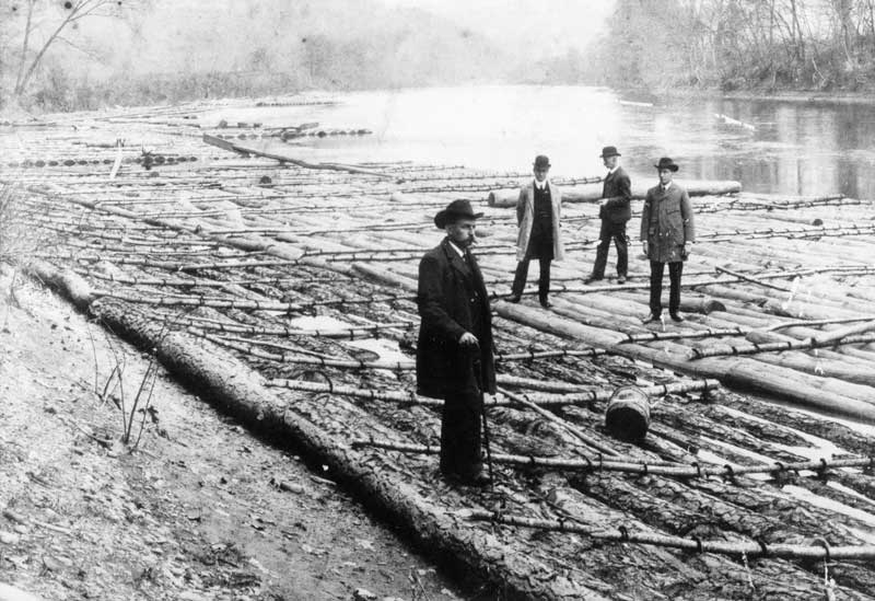 Ready to send a log raft down the river: Fred Eilenberger, Clinton Staples, Dr. J.H. Shull and Clinton Eilenberger. Rafting for the lumber industry continued until 1910.
