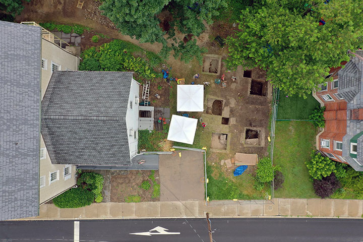 A drone flew over the mansion (left) to document the location of the digs in the back yard.