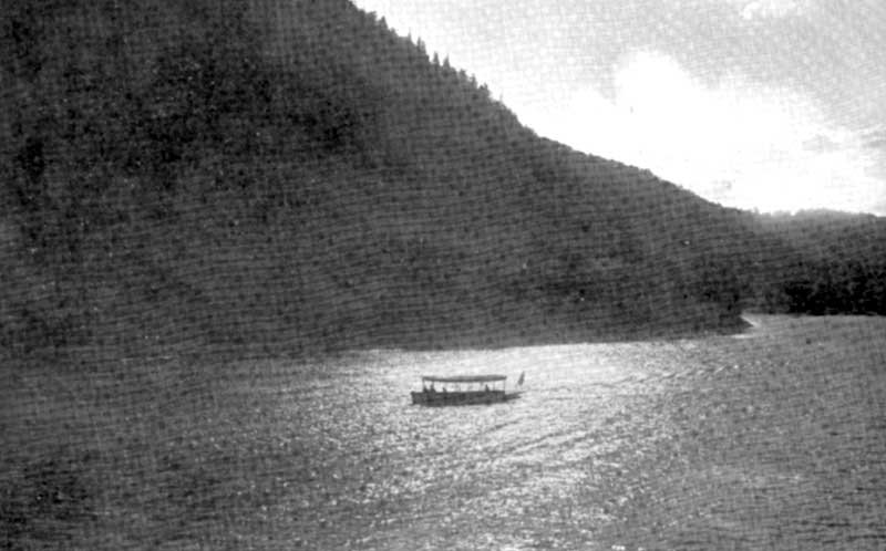 Moonlight on the Delaware River as a boat travels through the Delaware Water Gap, circa 1910.