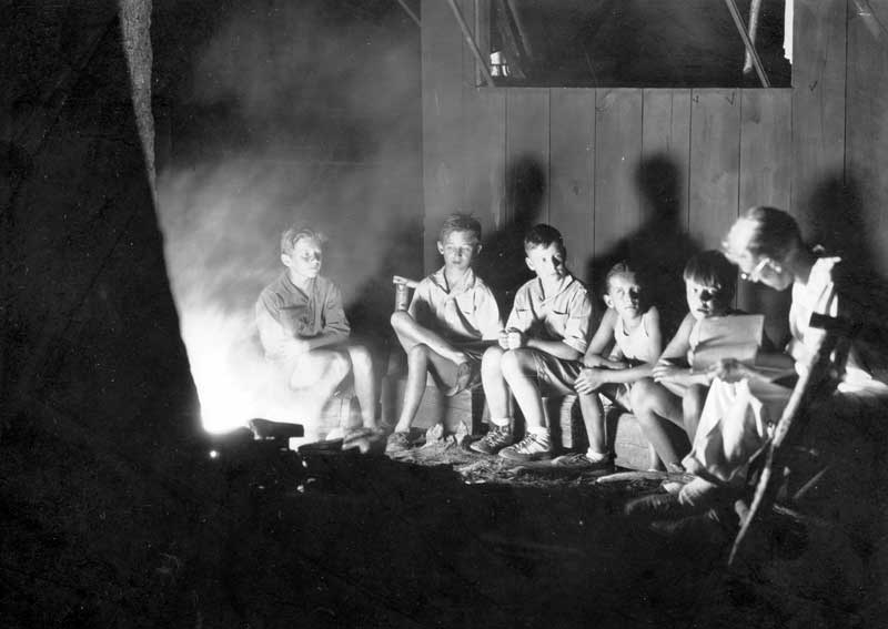 Storytelling around the campfire, 1930.