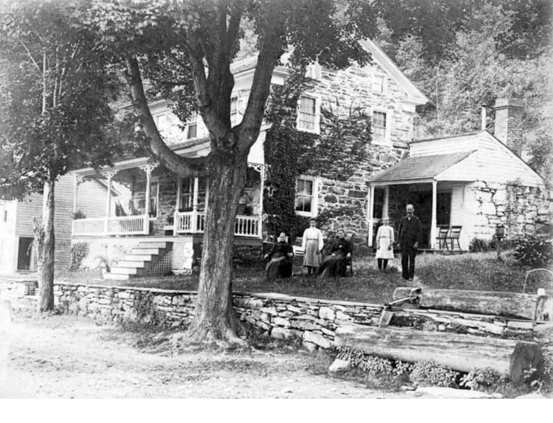 The Christian Kautz home on River Road north of Shawnee, circa 1900. In the photo, from left, are Mrs. Sarah (Clark) Kautz, Miss Betha Kautz, (unidentified), Miss Laura Koher and Christian Kautz.