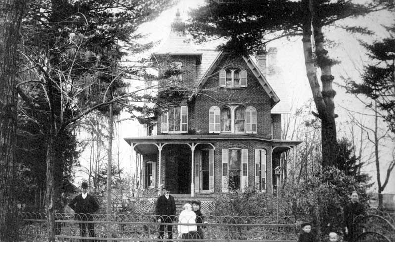 Home of Simon Meixell, circa late 1800s. From left are John U. Meixell, Simon Meixell, Lizzie Keller Meixell with baby, Harold K. Meixell, Mabel Meixell and Sophia Cornelia Metzgar Meixell.