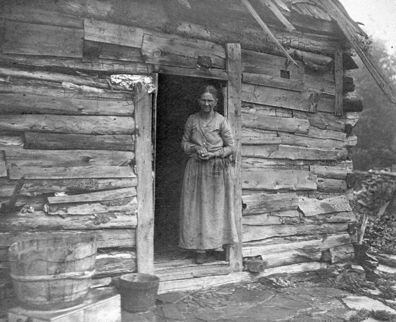 Polly Counterman in the doorway of her log home on Smokey Hill Road.