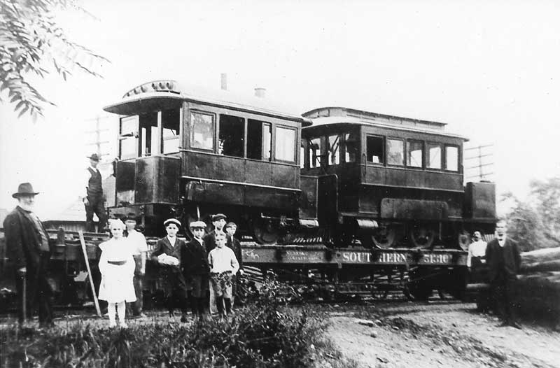 "In 1895, engines called ""dummies"" pulled trolley cars. This trolley, on a flatbed, was headed to Stroudsburg, where it would be unloaded."