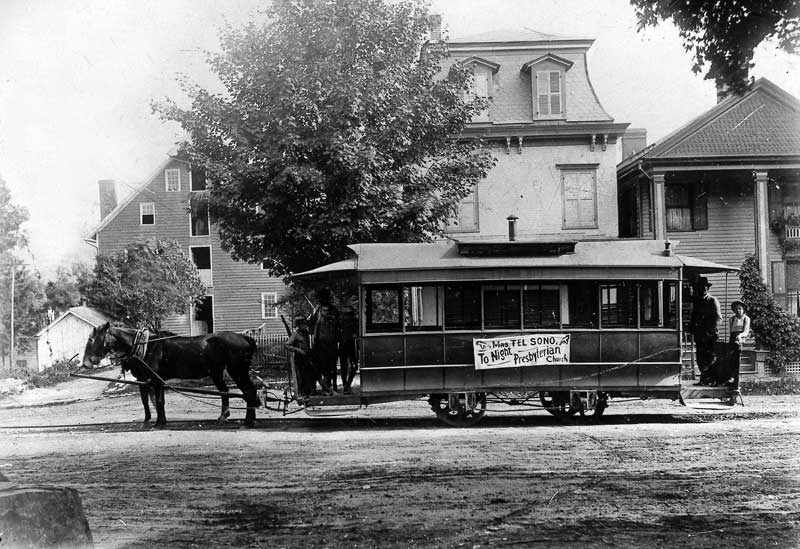 Horsedrawn trolley with Ackerman's Flour Mill to the left, circa 1892.