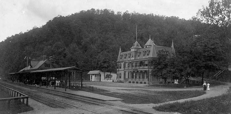 Delaware House in Delaware Water Gap with the railroad station in the foreground, 1880s.